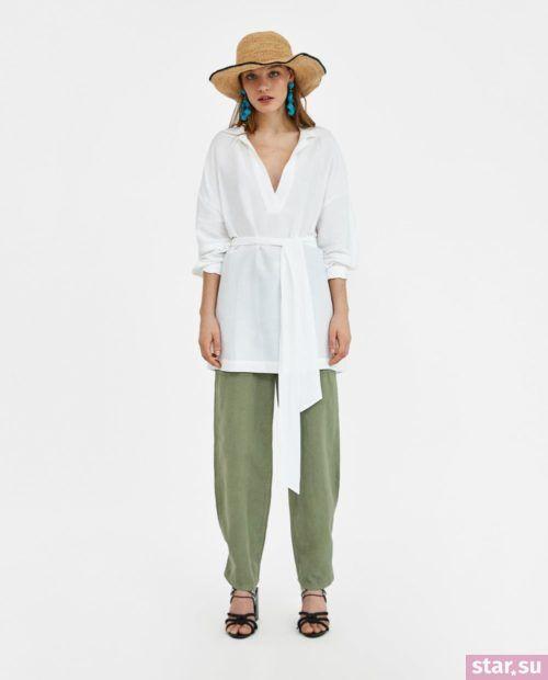 Стильные летние образы 2019: зеленые брюки и рубашка белая