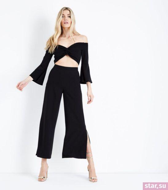 с чем носить укороченные брюки: широкие черные с разрезами