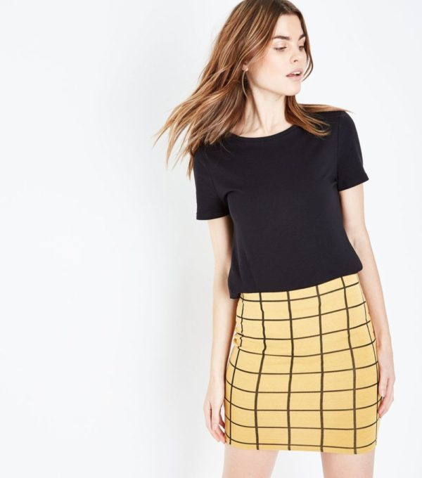 женская желтая в клетку юбка весна лето 2019 года
